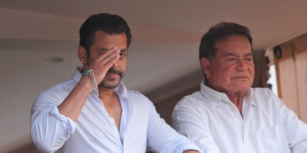Bollywood actor Salman Khan greets fans from the balcony of his home, with his father Salim Khan standing by his side in Mumbai, India, Friday, May 8, 2015. A court on Friday granted bail to Khan, one of India's biggest movie stars until it hears his appeal challenging his conviction in a drunk-driving hit-and-run case more than a decade ago. (AP Photo)