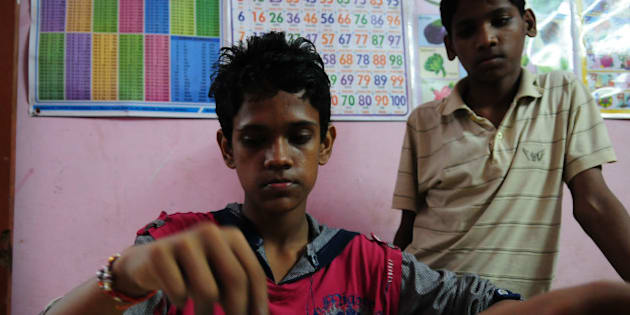 BHOPAL, INDIA - SEPTEMBER 7: Pakistani boy Mohammad Ramzan playing chess with inmates of shelter home run by NGO Ummeed on September 7, 2015 in Bhopal, India. Mohd Ramzan, 15, was separated from his mother at an early age of 10 when his father Mohammad Kazol took him to Bangladesh and remarried. Tortured by his step-mother, whom his father supported, Ramzan crossed borders to India, passed through Ranchi, Mumbai, New Delhi and landed in Bhopal. HT found him at Ummeed, a shelter home where he said that he wished to return to Pakistan. (Photo by Mujeeb Faruqui/Hindustan Times via Getty Images)