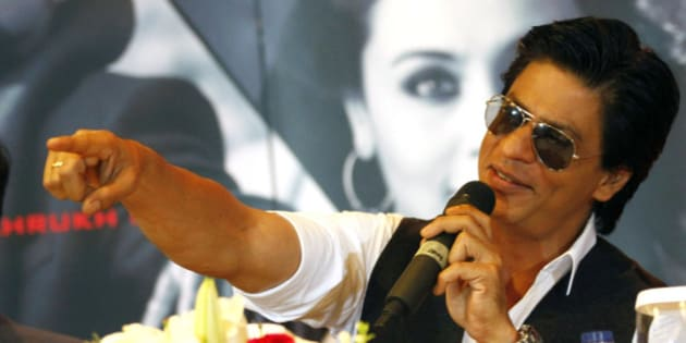 "Bollywood actor Shah Rukh Khan gestures during a press conference ahead of his ""Temptation Reloaded"" concert in Jakarta, Indonesia, Friday, Dec. 7, 2012. (AP Photo/Achmad Ibrahim)"