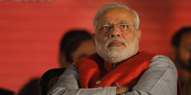 India's main opposition Bharatiya Janata Party (BJP) prime ministerial candidate Narendra Modi attends the party's two-day long National Council meeting beginning Saturday to chalk out election strategy, in New Delhi, India, Saturday, Jan. 18, 2014. Modi has been accused of looking the other way while his state suffered one of India's worst outbreaks of religious violence in 2002 and critics question whether the Hindu nationalist chief can be a truly secular leader over India's many cultures. (AP Photo/Altaf Qadri)