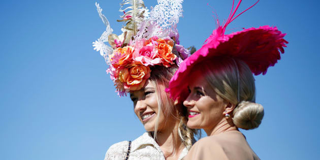 MELBOURNE, AUSTRALIA - NOVEMBER 03:  Racegoers enjoy the atmosphere on Melbourne Cup Day at Flemington Racecourse on November 3, 2015 in Melbourne, Australia.  (Photo by Zak Kaczmarek/Getty Images for the VRC)
