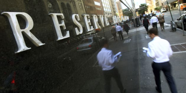 People walk past the Reserve Bank of Australia building in Sydney, Tuesday, Dec. 4, 2012. The Reserve Bank of Australia's decision to lower the rate to 3 percent marked the bank's fourth rate cut this year and was widely predicted by economists. (AP Photo/Rick Rycroft)