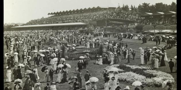 """Stand and Hill, Flemington, Melbourne Cup.  Parasols are much in evidence.  Find out more about this image, or download a hi-res copy, by checking out our catalogue: <a href=""""http://handle.slv.vic.gov.au/10381/74302"""" rel=""""nofollow"""">handle.slv.vic.gov.au/10381/74302</a>"""