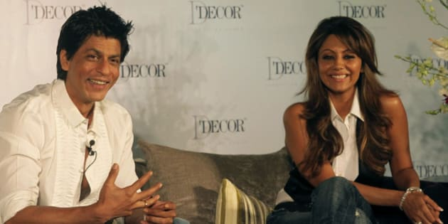 Bollywood actor Shah Rukh Khan, left, and his wife Gauri Khan look on during an event in Mumbai, India, Thursday, Aug. 26, 2010. (AP Photo/Rafiq Maqbool)