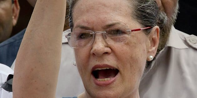 "India's opposition Congress party president Sonia Gandhi shouts slogans against the government during a protest in the parliament premises, in New Delhi, India, Tuesday, Aug. 4, 2015. Tuesday's protest followed after the speaker of India's Parliament on Monday barred 25 opposition legislators from its sessions for the rest of the week for causing ""grave disorder"" after they created noisy scenes.  The opposition has been demanding that two leaders of the ruling Bharatiya Janata Party resign for allegedly helping a former Indian cricket official facing investigation for financial irregularities. (AP Photo/ Manish Swarup)"