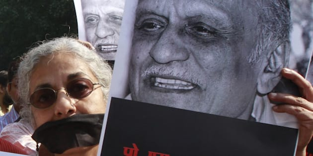 NEW DELHI, INDIA - OCTOBER 23: Writers, readers and cultural activists participate in a silent protest against MM Kalburgi's murder at Mandi House, on October 23, 2015 in New Delhi, India. The Sahitya Akademi said that it was deeply pained over the dastardly murder of noted writer MM Kalburgi and other intellectuals and urged the writers to take back the awards they returned to denounce the Akademi's silence and growing intolerance. Over 100 litterateurs have returned their Akademi awards to protest primarily against the attacks by some Hindutva groups on writers and thinkers like MM Kalburgi. (Photo by Sanjeev Verma/Hindustan Times via Getty Images)