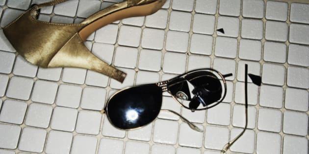 Broken sunglasses and high heel shoe