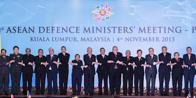 KUALA LUMPUR, MALAYSIA - NOVEMBER 04:  From left to right, Australia's Defense Minister Marise Payne, Brunei's Defense Minister Mohammad Yasmin Umar, Cambodia's Defense Minister Gen. Tea Banh, China's Defense Minister Chang Wanquan, India's Defense Minister Manohar Parrikar, Indonesia's Defense Minister Ryamizard Ryacudu, Japan's Defense Minister Gen Nakatani, Myanmar's Defense Minister Sein Win, Laos' Defense Minister Sengnouane Sayalat, Malaysia's Prime Minister Najib Razak, Malaysia's Defense Minister Hishamuddin Hussein, New Zealand's Defense Minister Gerry Brownlee, Philippines' Secretary of Defense Voltaire Gazmin, South Korea's Defense Minister Han Min Koo, Russia's Deputy Defense Minister Anatoly Antonov, Singapore's Defense Minister Ng Eng Hen, Thailand's Defense Minister Gen. Prawit Wongsuwon, U.S. Defense Secretary Ash Carter and Vietnam's Deputy Defense Minister Nguyen Van Hein joint hands as they pose for photographers after during the ASEAN defence ministers meeting plus 2015 on November 4, 2015 in Kuala Lumpur, Malaysia. Asean face pressure to back China on the South China Sea issue, while the US and Japan are pushing to get concerns about the dispute included in a statement to be issued after regional defence talks.  (Photo by Mohd Samsul Mohd Said/Getty Images)
