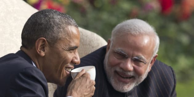 President Barack Obama and Indian Prime Minister Narendra Modi have coffee and tea in the gardens of the Hyderabad House in, New Delhi, India, Sunday, Jan. 25, 2015. (AP Photo/Carolyn Kaster)
