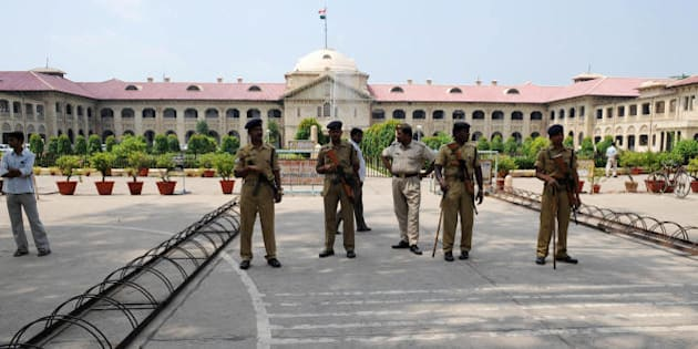 Indian Central Reserve Police Force (CRPF) personnel stand guard at the Allahabad High Court during a strike by Allahabad High Court Bar Association (HCBA) lawyers in Allahabad on September 15, 2009. The HCBA called a strike over the issue of a proposed bifurcation of the Allahabad High Court, the imposition of VAT, and the division and shifting of central government offices from Allahabad. AFP PHOTO/Diptendu DUTTA (Photo credit should read DIPTENDU DUTTA/AFP/Getty Images)