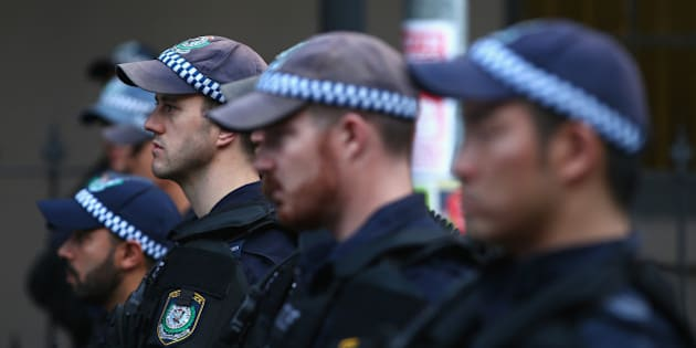 SYDNEY, AUSTRALIA - OCTOBER 09:  Police watch on as they separate protestors in Marden street outside Parramatta Mosque on October 9, 2015 in Sydney, Australia. Protesters gathered at Parramatta Mosque after calls for its destruction by the group 'Party for Freedom'. It is alleged Farhad Jabar attended the mosque sometime before he murdered Police worker Curtis Cheng earlier this week.  (Photo by Mark Kolbe/Getty Images)