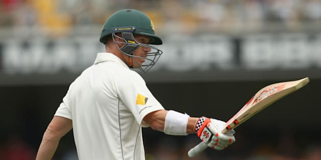 BRISBANE, AUSTRALIA - NOVEMBER 05:  David Warner of Australia celebrates after reaching his half century during day one of the First Test match between Australia and New Zealand at The Gabba on November 5, 2015 in Brisbane, Australia.  (Photo by Mark Kolbe/Getty Images)