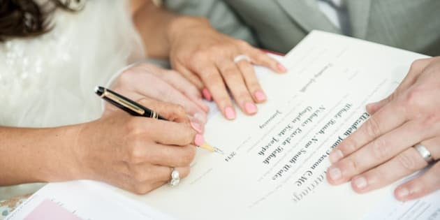 Bride & Groom signing marriage certificate