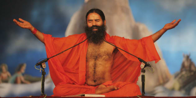 Indian yoga guru Baba Ramdev performs yoga at Sangam, the confluence of rivers Ganges, Yamuna and mythical Saraswati during the Maha Kumbh festival in Allahabad, Monday, Feb. 4, 2013. Millions of Hindu pilgrims are expected to attend the Maha Kumbh festival, which is one of the world's largest religious gatherings that lasts 55 days and falls every 12 years. (AP Photo/Rajesh Kumar Singh)