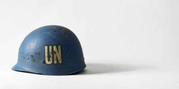 United Nations blue peacekeeper's helmet with the initials UN on side