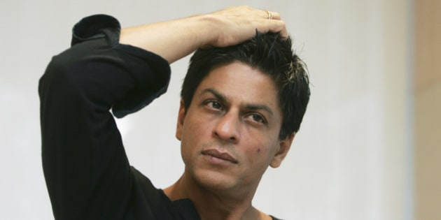 Bollywood actor Shah Rukh Khan gestures during an interview with The Associated Press at his residence in Mumbai, India, Monday, Dec. 8, 2008. Khan, one of the biggest stars in the world's biggest movie industry, wept at a recent movie preview for Mumbai's shattered sense of security after militants laid waste to it in a bloody three-day attack. (AP Photo/Gautam Singh)