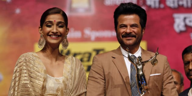 Bollywood actor Anil Kapoor stands with his daughter Sonam Kapoor after he received the Master Dinanath Mangeshkar Award 2015 in Mumbai, India, Friday, April 24, 2015. (AP Photo/Rajanish Kakade)