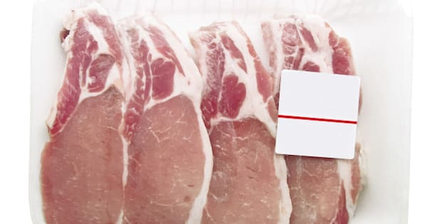 Pork chops packaged in a container with a price tag