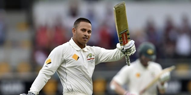 Australia's batsman Usman Khawaja celebrates his first Test century during day one of the first Test cricket match between Australia and New Zealand in Brisbane on November 5, 2015. AFP PHOTO / Saeed KHAN IMAGE STRICTLY RESTRICTED TO EDITORIAL USE - STRICTLY NO COMMERCIAL USE        (Photo credit should read SAEED KHAN/AFP/Getty Images)