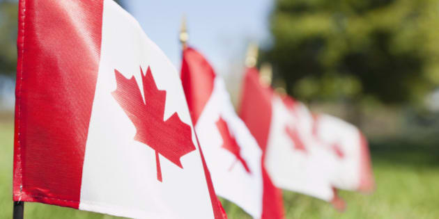 USA, Illinois, Metamora, Canadian flags in cemetery