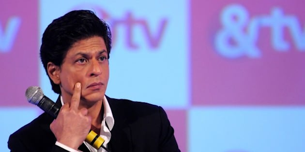 Indian Bollywood actor Shah Rukh Khan during the launch of the new Hindi general entertainment television channel '&TV' and its flagship show 'Poochega  Sabse Shaana Kaun' in Mumbai on January 21, 2015. AFP PHOTO/STR        (Photo credit should read STRDEL/AFP/Getty Images)