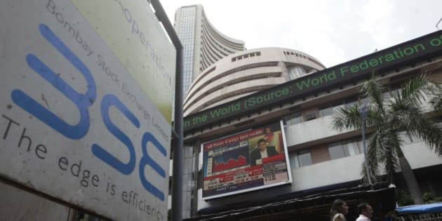 MUMBAI, INDIA - AUGUST 24: People walk outside the Bombay Stock Exchange on August 24, 2015 in Mumbai, India. Sensex crashed over 1700 points or 6.22 per cent in pre-close trade with the investor wealth down by over Rs. 7 lakh crore with nearly Rs. 4 lakh crore lost in an hour. (Photo by Kunal Patil/Hindustan Times via Getty Images)