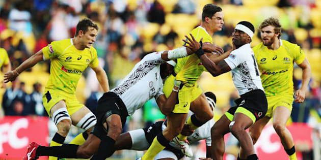 WELLINGTON, NEW ZEALAND - FEBRUARY 07:  Greg Jeloudev of Australia charges forward during the Plate Final match between Australia and Fiji in the 2015 Wellington Sevens at Westpac Stadium on February 7, 2015 in Wellington, New Zealand.  (Photo by Hannah Peters/Getty Images)