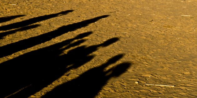 Djabal refugees camp - shadows of some sudanese people gathered  in  the camp.