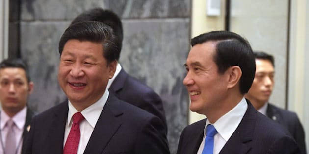 Chinese President Xi Jinping, left, and Taiwanese President Ma Ying-jeou, right, smile as they enter the room at the Shangri-la Hotel where they met on Saturday, Nov. 7, 2015, in Singapore. The two leaders shook hands at the start of a historic meeting marking the first top level contact between the formerly bitter Cold War foes since they split amid civil war 66 years ago. (AP Photo/Joseph Nair, pool)