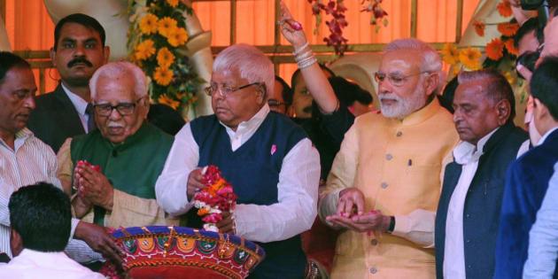 SAIFAI, INDIA - FEBRUARY 21: Prime minister Narendera Modi, RJD chief Lalu Prasad Yadav, SP national president Mulayam Singh Yadav and UP Governor Ram Naik showering flower petals during the pre-wedding ceremony of Samajwadi Party supremo Mulayam Singh Yadav's grandnephew Tej Pratap Yadav on February 21, 2015 in Saifai, India. Mr. Tej Pratap is marrying Rashtriya Janata Dal chief Lalu Prasad Yadav's youngest daughter. (Photo by Ashok Dutta/Hindustan Times via Getty Images)