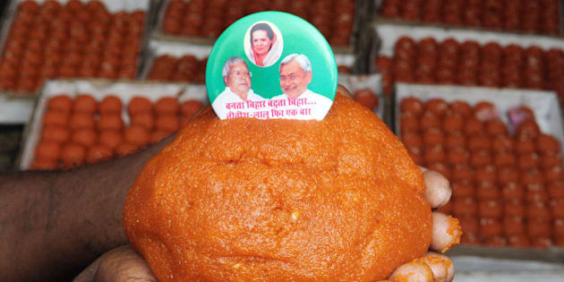 PATNA, INDIA - NOVEMBER 7: Special ladoos being made for Lalu Yadav and Nitish Kumar by the order of JDU leaders on the eve of Bihar election, on November 7, 2015 in Patna, India. RJD Chief Lalu Yadav said he was confident that his Rashtriya Janata Dal (RJD) and the JD-U combine will win 190 of the 243 seats in the Bihar assembly. Bihar voted in five phases starting in October and ending earlier this week; the results will be counted on Sunday. The five-phase polling in the state of Bihar ended on November 6. Official results will be announced on November 8. (Photo by AP Dube/Hindustan Times via Getty Images)