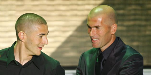 Lyon's Karim Benzema, left, reacts after he was voted 'best soccer player' of France's League One as former French international soccer player Zinedine Zidane looks on during the UNFP (Union of French Professional Footballers) awards ceremony, in Paris Sunday, May 11, 2008. (AP Photo/Jacques Brinon)