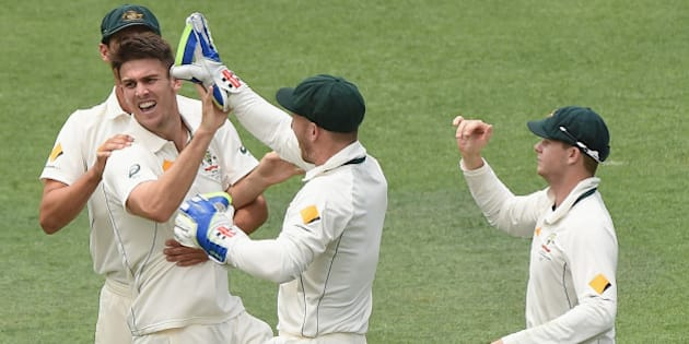BRISBANE, AUSTRALIA - NOVEMBER 09:  Mitch Marsh of Australia celebrates the wicket of Brendon McCullum of New Zealand  during day five of the First Test match between Australia and New Zealand at The Gabba on November 9, 2015 in Brisbane, Australia.  (Photo by Matt Roberts - CA/Cricket Australia/Getty Images)