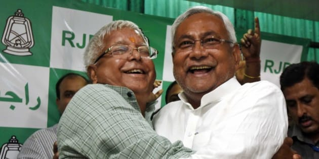 PATNA, INDIA - NOVEMBER 8: RJD Chief Lalu Prasad Yadav and Nitish Kumar celebrate after Mahagathbandhan's (Grand Alliance) victory in Bihar assembly elections at RJD office, on November 8, 2015 in Patna, India. Nitish Kumar said, 'I express my gratitude towards people of Bihar, will try our best to match up with their expectations. We respect our opposition in Bihar; want to work in consensus with everyone to develop Bihar. This victory is big win and we will work towards the Grand Alliances mandate for the development of Bihar.' Lalu Yadav said, 'BJP had its eyes on Kolkata, the capital of West Bengal. It wanted to move eastwards. Bihar stopped them in tracks. PM Narendra Modi is nothing but an RSS pracharak.' The grand alliances victory is also attributed to the rejection of communal politics, driven mostly by the recent debate over cow slaughter and consumption of beef. Data from the election commissions website for 240 of the states 243 seats showed the RJD-JD(U)-Congress alliance led in 178 seats, an emphatic victory over the NDA that could only win around 59 seats. (Photo by Arun Sharma/Hindustan Times via Getty Images)