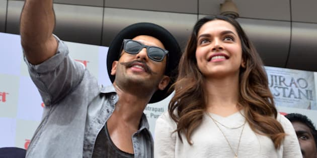 MUMBAI,INDIA SEPTEMBER 15: Ranveer Singh and Deepika Padukone at the launch from their upcoming move Bajirao Mastani in Mumbai.(Photo by Milind Shelte/India Today Group/Getty Images)