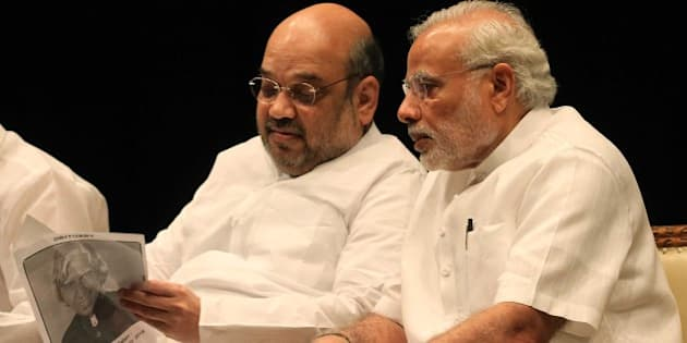 NEW DELHI, INDIA - JULY 28: Prime Minister Narendra Modi with BJP President Amit Shah at BJP Parliamentary party leaders meeting at the Parliament House Library during the ongoing Monsoon Session, on July 28, 2015 in New Delhi, India. As a mark of respect to the departed former President A.P.J. Abdul Kalam, members of both Houses stood in silence before the proceedings were adjourned for the day. Both Houses were adjourned till July 30. (Photo by Sonu Mehta/Hindustan Times via Getty Images)