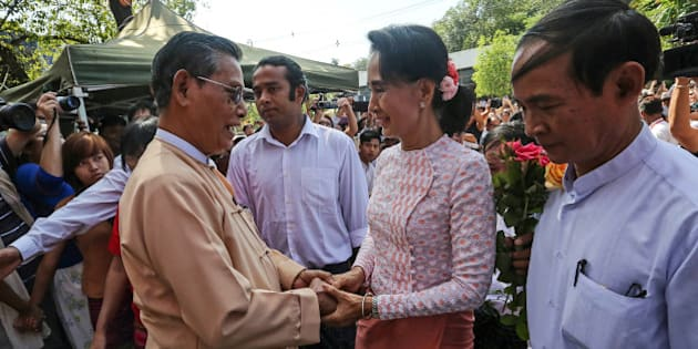 Aung San Suu Kyi, Myanmar's opposition leader and chairperson of the National League for Democracy (NLD), center right, greets Tin Oo, co-founder of the NLD, as she arrives at the party headquarters in Yangon, Myanmar, on Monday, Nov. 9, 2015. Suu Kyi warned supporters anticipating an historic election victory over the military-backed ruling party that results are not final and they need to remain cautious. Photographer: Dario Pignatelli/Bloomberg via Getty Images
