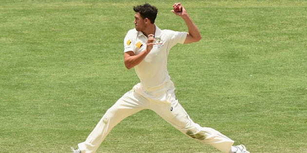 BRISBANE, AUSTRALIA - NOVEMBER 09: Mitchell Starc of Australia fields off his own bowling during day five of the First Test match between Australia and New Zealand at The Gabba on November 9, 2015 in Brisbane, Australia.  (Photo by Matt Roberts - CA/Cricket Australia/Getty Images)