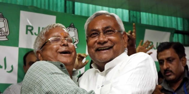 PATNA, INDIA - NOVEMBER 8: RJD Chief Lalu Prasad Yadav and Nitish Kumar celebrate after Mahagathbandhan's (Grand Alliance) victory in Bihar assembly elections at RJD office, on November 8, 2015 in Patna, India. Nitish Kumar said, 'I express my gratitude towards people of Bihar, will try our best to match up with their expectations. We respect our opposition in Bihar; want to work in consensus with everyone to develop Bihar. This victory is big win and we will work towards the grand alliances mandate for the development of Bihar.' Lalu Yadav said, 'BJP had its eyes on Kolkata, the capital of West Bengal. It wanted to move eastwards. Bihar stopped them in tracks. PM Narendra Modi is nothing but an RSS pracharak.' The grand alliances victory is also attributed to the rejection of communal politics, driven mostly by the recent debate over cow slaughter and consumption of beef. Data from the election commission's website for 240 of the state's 243 seats showed the RJD-JD(U)-Congress alliance led in 178 seats, an emphatic victory over the NDA that could only win around 59 seats. (Photo by Arun Sharma/Hindustan Times via Getty Images)