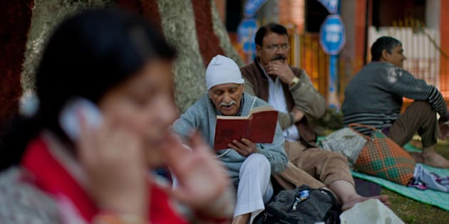 SRINAGAR, KASHMIR, INDIA - MAY 26: An elderly Kashmiri Pandit (Hindu) devotee recites Holy Bagavad Gita  during the annual Hindu festival of the Kheer Bhawani in it's namesake temple on May 26, 2015 in Tullmull 25 Km east of Srinagar, the summer capital of Indian Administered Kashmir, Indian. Thousands of Pandit devotees line up in the Spring with plates of sugar and milk and other sweets to pay homage to the Goddess Kheer Bhawani. Some 200,000 Kashmiri Pandits fled the region in the early nineties at the start of an insurgency against Indian rule mainly to the Hindu-dominated southern city of Jammu. Many have returned since under various rehabilitation packages launched by the government. (Photo by Yawar Nazir/ Getty Images)