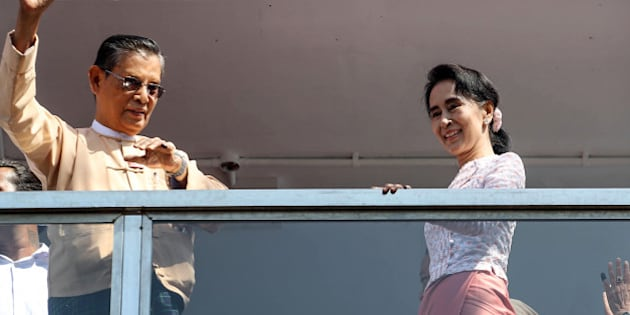 Aung San Suu Kyi, Myanmar's opposition leader and chairperson of the National League for Democracy (NLD), right, and U Thin Oo, vice-chairman of the NLD, stand on a balcony at the party headquarters in Yangon, Myanmar, on Monday, Nov. 9, 2015. Suu Kyi warned supporters anticipating an historic election victory over the military-backed ruling party that results are not final and they need to remain cautious. Photographer: Dario Pignatelli/Bloomberg via Getty Images