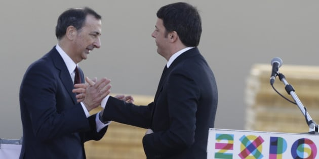 "Italian Premier Matteo Renzi, right, greets Giuseppe Sala, Commissioner of  Expo 2015, during his visit at the Expo site in Rho, near Milan, Italy, Friday, March 13, 2015. The theme of the Expo 2015 in Milan is ""Feeding the Planet, Energy for Life"". (AP Photo/Luca Bruno)"