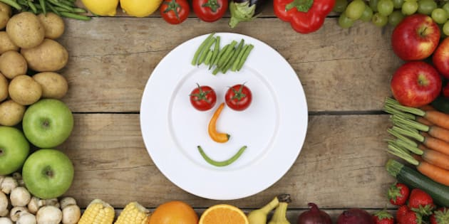 Healthy eating smiling face from vegetables and fruits on plate
