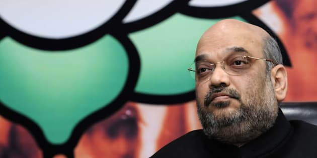 NEW DELHI, INDIA - SEPTEMBER 26: Bharatiya Janata Party (BJP) President Amit Shah during the launch of the his website 'www.amitshah.co.in', who hoped, it will help to interact with the people of the country and party workers, at the party headquarters at Ashoka Road, on September 26, 2015 in New Delhi, India. Shah said that different activities of the party, government and his own activities will be available on the website which will help dissemination of information to workers. (Photo by Saumya Khandelwal/Hindustan Times via Getty Images)