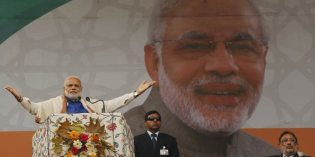 Indian Prime Minister Narendra Modi speaks during a public rally in Srinagar, Indian controlled Kashmir, Saturday, Nov. 7, 2015. Modi on Saturday promised a $12 billion federal aid package to boost economic growth in the Indian-controlled portion of the troubled Kashmir region. (AP Photo/Mukhtar Khan)