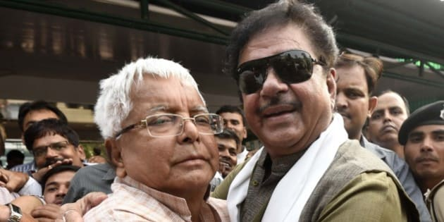 PATNA, INDIA - NOVEMBER 9: BJP leader Shatrughan Sinha hugs the RJD Chief Lalu Prasad Yadav after landslide victory of the grand alliance in Bihar Assembly Elections on November 9, 2015 in Patna, India. The newly-formed JD(U)-RJD-Congress alliance defeated Narendra Modi led NDA alliance by securing 178 seats in the 243-member House. RJD emerged the leader of the pack with 80 seats while JD(U) bagged 71 in the recently-concluded Bihar polls. (Photo by Arun Sharma/Hindustan Times via Getty Images)