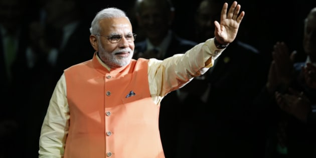 Prime Minister Narendra Modi of India waves to the crowd as he arrives to give a speech during a reception by the Indian community in honor of his visit to the United States at Madison Square Garden, Sunday, Sept. 28, 2014, in New York. (AP Photo/Jason DeCrow)