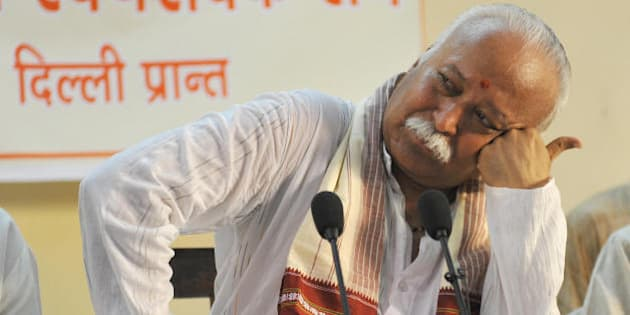 Rashtriya Sawayamsevak Sangh (RSS) chief, Mohan Rao Bhagwat listens to a question during a press conference in New Delhi on August 28, 2009.  Concerned over the current turmoil in the Bharatiya Janata Party (BJP) the RSS called for an end to the infighting in the party.  AFP PHOTO/ Manpreet ROMANA (Photo credit should read MANPREET ROMANA/AFP/Getty Images)