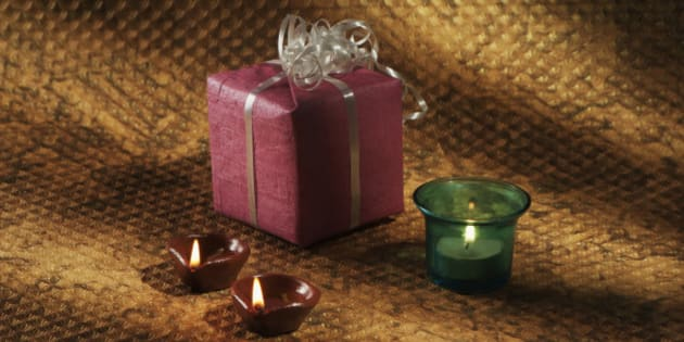 Gift, candle and oil lamps on Diwali