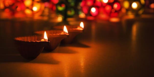 three beautiful diwali diyas, selective focus, bokeh in the background, perfect for diwali greeting